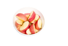 Apple Cuts. Cut red apple in bowl isolated on white Royalty Free Stock Images