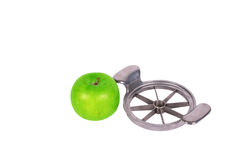 Apple cutter and green apple Royalty Free Stock Image