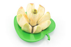 Apple with cutter Royalty Free Stock Photos