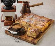 Apple Danish cake with a cup of coffee. On a background of an old coffee grinder Stock Photography