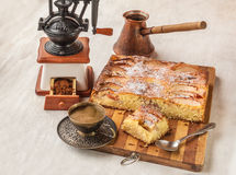 Apple Danish cake with a cup of coffee. On a background of an old coffee grinder Stock Photo
