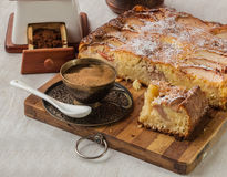 Apple Danish cake with a cup of coffee. On a background of an old coffee grinder Royalty Free Stock Photos