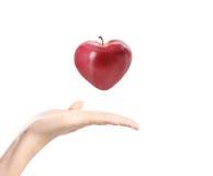 Apple dans une main Images stock