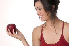 Woman Enjoys Touching Holding Red Delicous Apple Royalty Free Stock Image