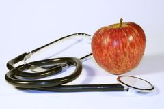 An apple a day. Apple and stethoscope royalty free stock images