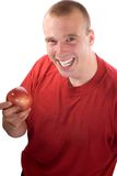 An apple a day. Young man holding an apple, healthy eating concept stock photography