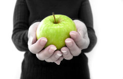 Apple a day 3. Woman holding a green apple into the camera stock images