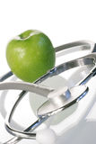 Apple a day. Apple stethoscope health stock photography