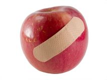 An apple a day keeps the doctor away. A fuji apple with a band-aid on it Stock Image
