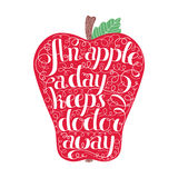 An apple a day keeps the doctor away lettering in apple. Stamp design. Stock Photos