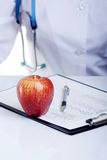 Apple a day keeps the doctor away Stock Photography