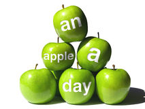 Apple a Day Pyramid. A Pyramid of Green Apples with Four Bearing the Words  An Apple a Day Royalty Free Stock Photos