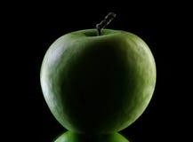 Apple in der Dunkelheit Stockfotografie