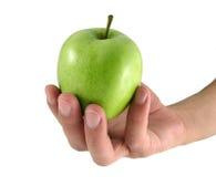 Apple in der männlichen Hand Stockfoto