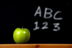 Apple on a desk Stock Images