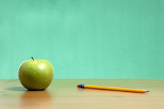 Apple on a desk. An apple on a desk in the classroom stock images