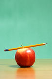Apple on a desk Royalty Free Stock Photography