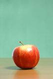 Apple on a desk Stock Image