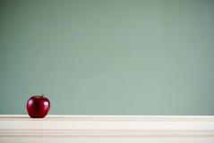 Apple on desk Stock Photo