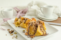 Apple dessert. Baked apples with chocolate and almonds Stock Image