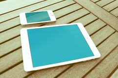 Apple Devices. On Wooden Table Royalty Free Stock Photos