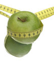 Apple Diet. Green apple and measuring tape; diet image royalty free stock images