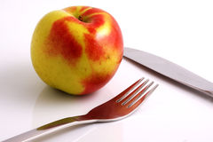 Apple diet. Knife and fork Stock Image