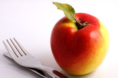 Apple diet. Knife and fork Royalty Free Stock Photos