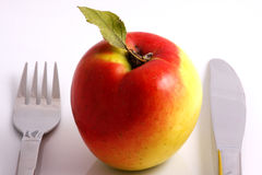 Apple diet. Knife and fork Royalty Free Stock Photo