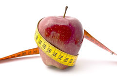Apple Diet. Red apple and tape measure  on white Stock Photography