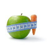 Apple Diet. Macro image depicting a diet concept against a white background. Copy space stock image