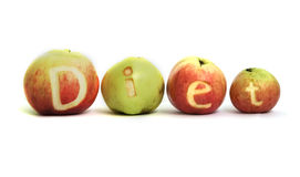 Apple Diet. Word DIET cut out in 4 apples Stock Image