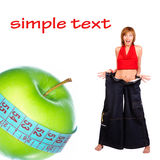 Apple diet. Smiling woman, tape, green apple. Isolated  over white background Royalty Free Stock Image