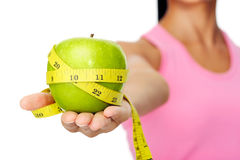Apple diet concept. Healthy happy hispanic woman with apple and tape measure for diet and weight loss concept Stock Photo