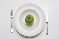 Apple -diet food on a plate Royalty Free Stock Photos