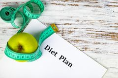 Apple, diet plan and measuring tape Stock Images
