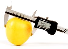 Apple and Digital Micrometer Stock Photography