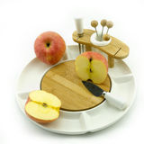 Apple on plate. Apples on a white china fruit plate Stock Photos