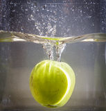 Apple dive in the water Stock Image