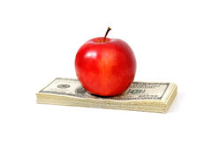 Apple and dollars Stock Image