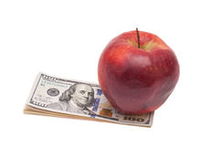 Apple and dollars Stock Photo