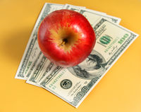 Apple is on the dollars Royalty Free Stock Photography