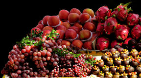 Apple dragonfruit grapes figs Stock Images
