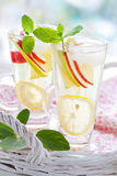 Apple drink. With lemon,mint and ice cubes stock images