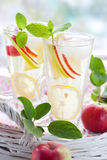 Apple drink. With lemon,mint and ice cubes Royalty Free Stock Photos