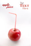 Apple with drinking straw Royalty Free Stock Photos