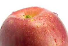 Apple with droplets close up Stock Images