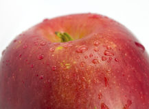 Apple with droplets close up. On the isolated white background Royalty Free Stock Photo