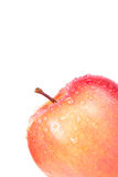 Apple with drops in the corner isolated on a white background. S Stock Photo