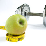 Apple and dumbbell Royalty Free Stock Photos